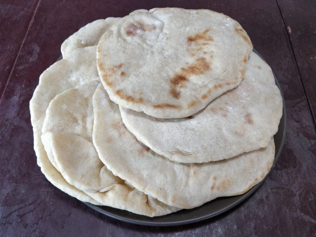 Pita breads stacked on a plate