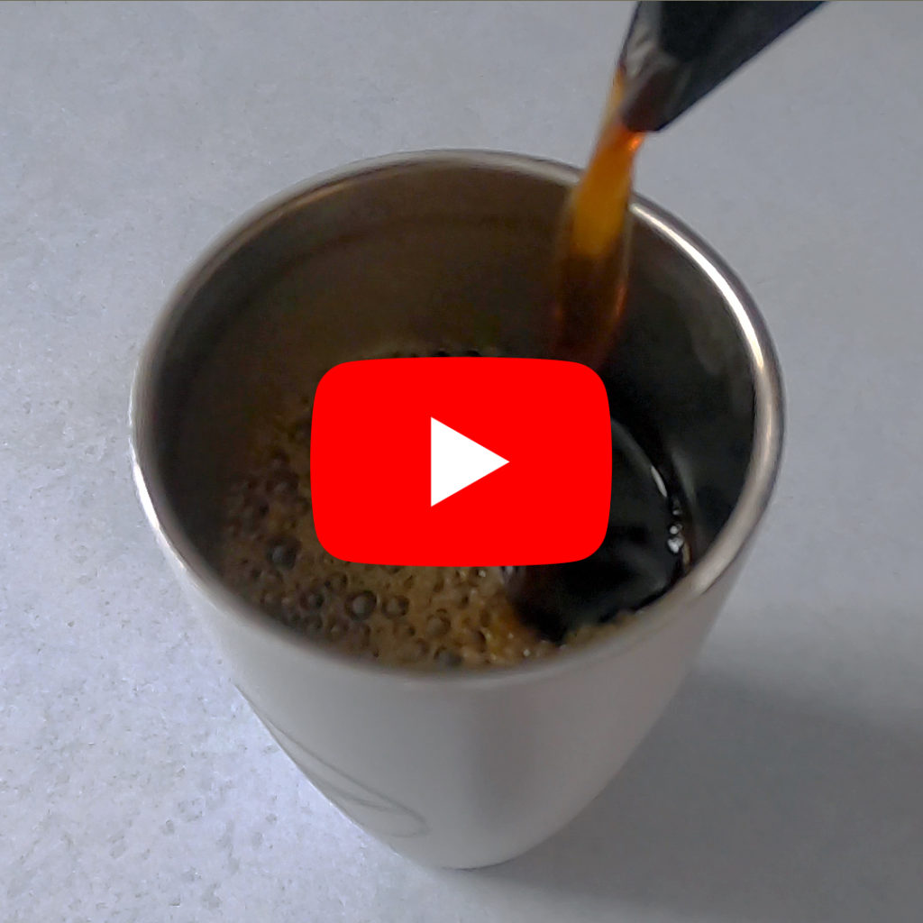 Coffee pouring into a cup with the YouTube logo in front