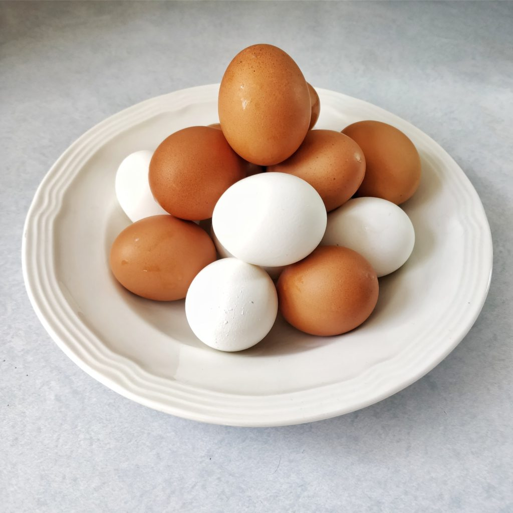 Brown and white unpeeled eggs